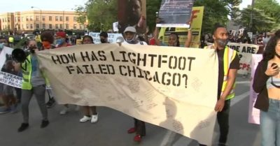 Hundreds march on Chicago mayor Lightfoot's inauguration anniversary, calling out her policies