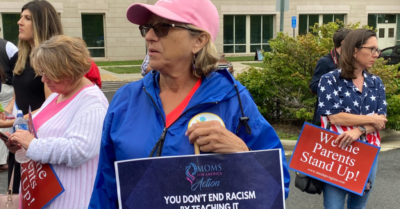 Parents arrested after opposing critical race theory during school meeting