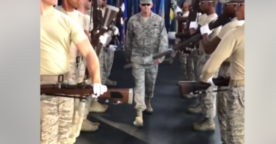 Air Force colonel walks through drill team's rifles with fixed bayonets
