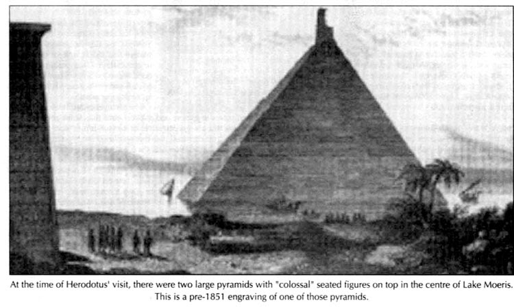 at the time of herodotus visit, there were two large pyramids with colossal seated figures on top in the center of lake moeris